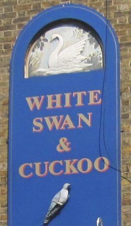 The Sign over the White Swan and Cuckoo Pub